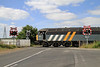 A Bit of a Arty Farty Shot of 56301 Crossing The Main Road On The Approach To Potland Burn Surface Mine With The 08.38 Empty Tubs From Holgate Sidings on Wed 17-7-2013.