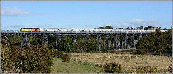 2018 09 24.60096 on the 10.15 Lynemouth p.s.-Tyne C.Terminal empty biomass hoppers above the River Wansbeck on the North Seaton viaduct.