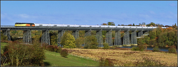 2018 10 27 60002 on the10.27 Lynemouth p.s.-Tyne Coal Terminal empty biomass hoppers  approaches Marcheys House signal box on the North Seaton viaduct.