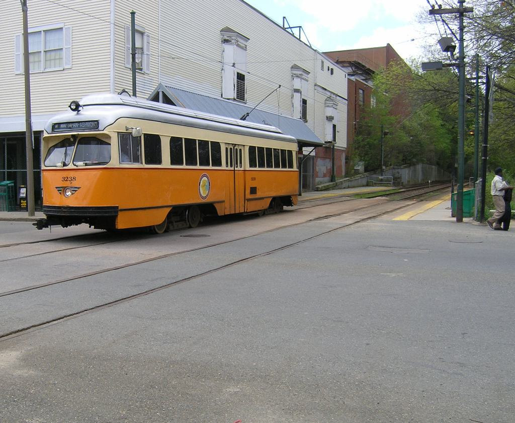 "A ""PCC"" class streetcar at Central Avenue Station in Milton. PCC's were once seen all over the metropolitan area working for the Boston Elevated Company, the Metropolitan Transit Authority (MTA), and in recent years the Massachusetts Bay Transportation Authority. Now they are only found on the Mattapan to Ashmont Line. This one has been repainted back to its orignal colors as it was delivered from the factory in 1945"