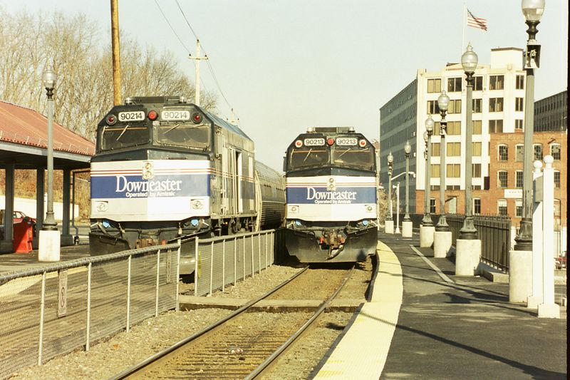 Inbound (left) and outbound (right) Downeaster trains meet at Haverhill, MA. This is the former B&M Portland Division. The old B&M depot is long gone. The MBTA has constructed a shelter and parking lot here. Haverhill is the end of the line for MBTA commuter trains on this line
