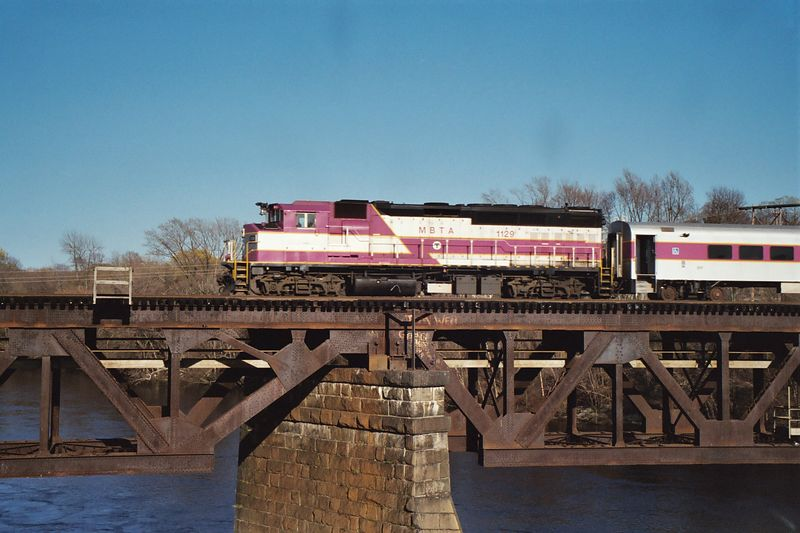This MBTA Commuter Train has just begun its run from Haverhill to Boston. It is crossing the Merrimack River in Haverhill.
