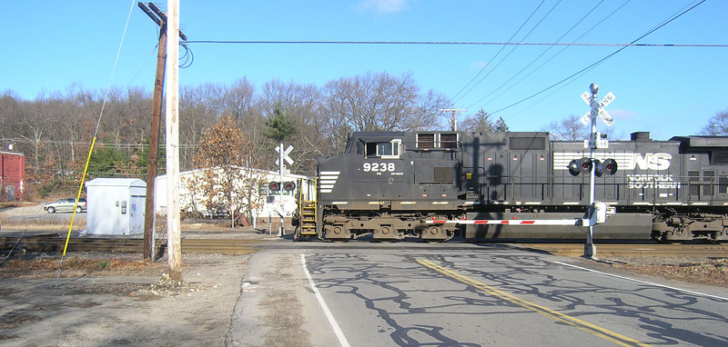 OLYMPUS DIGITAL CAMERA   . . . . . Dec. 12, 2006   - Norfolk Southern power on empty coal train. This is the first crossing east of Ayer Tower.