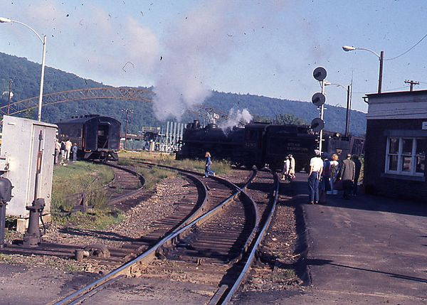 Bellows Falls, VT in 1976 - Steam train running on the Green Mountain RR crosses the diamond of the BM Connecticut River Main Line.