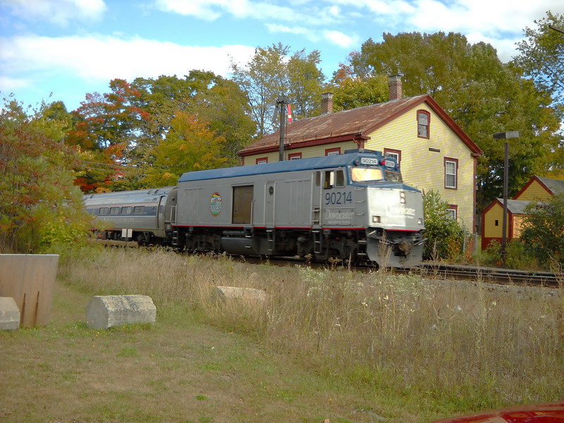 10/5/2009 - Amtrak train number 684, the Downeaster passes the restored former B&M depot at East Kingston, NH.