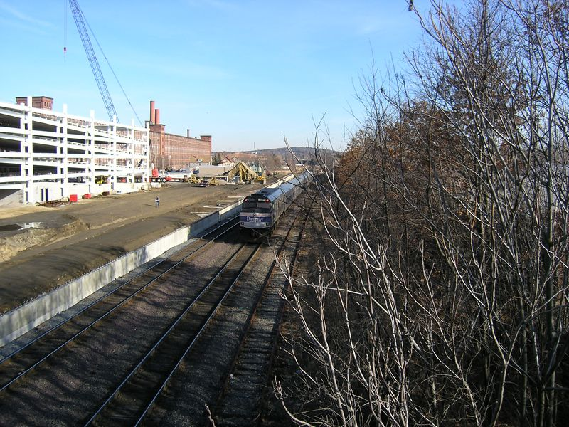 Lawrence, Mass. - Downeaster - Construction at left is for a new MBTA Commuter Rail Station with parking garage.