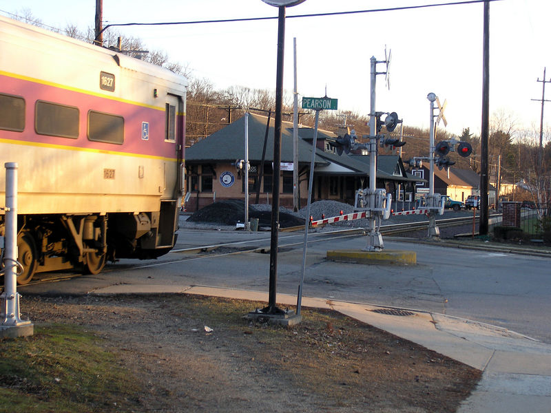 Control Car of train 2216 has just departed the modern MBTA boarding platform in Andover, MA. It is about to the pass the beautiful old depot building which now houses several non-rail related businesses. Date is 2/5/2006
