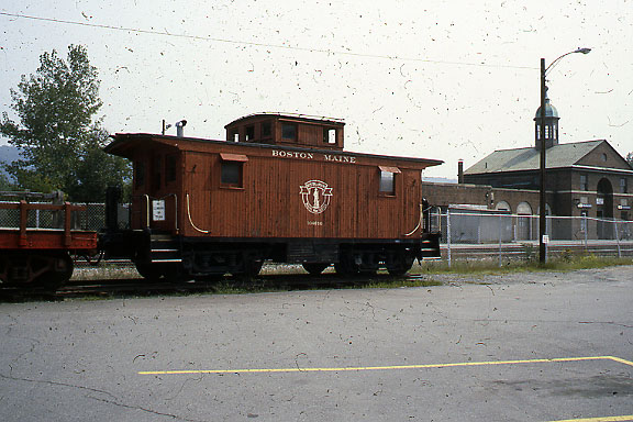 Old B&M wooden caboose at White River Junction, VT. Since this photo was taken, the caboose and associated steam engine have been moved across the tracks.