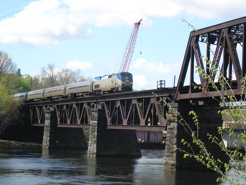 Amtrak train 681, The Downeaster crossing the Merrimack River into Haverhill, MA in May, 2006. This is the former Boston and Maine RR Portland Division, now owned by the MBTA