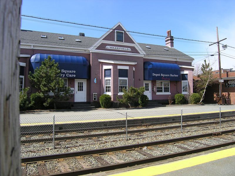 "Wakefield, MA - April 8, 2004 - There were once 3 stations with the word ""Wakefield"" in their name. They were Wakefield Junction, Wakefield Center (on the Newburyport Branch) and Wakefield. This station is plain Wakefield and is the only one where trains still stop. The building is no longer used by the railroad but  passenger platforms are still used by MBTA commuter trains. The MBTA calls this line the Reading / Haverhill Line. When it was owned by the Boston and Maine it was the busy Western Route Main Line of the Portland Division"