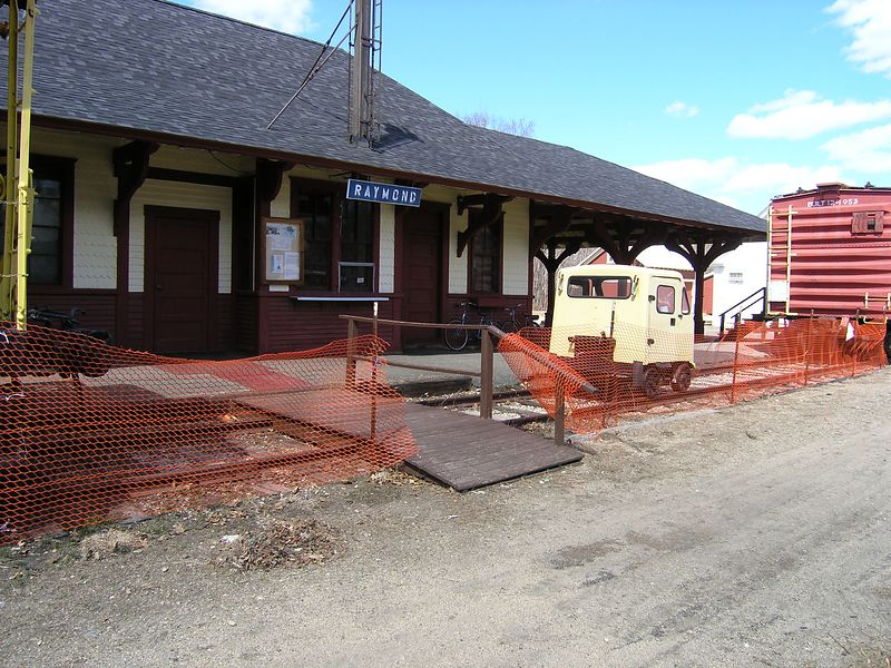 Former Boston and Maine Depot at Raymond, NH on 4/10/2004. This depot stands on the abandoned Portsmouth Branch (now a snowmobile trail). The track in the foreground is deceptive. It is not connected to anything, it is just long enough to hold the track speeder and a few antique cars