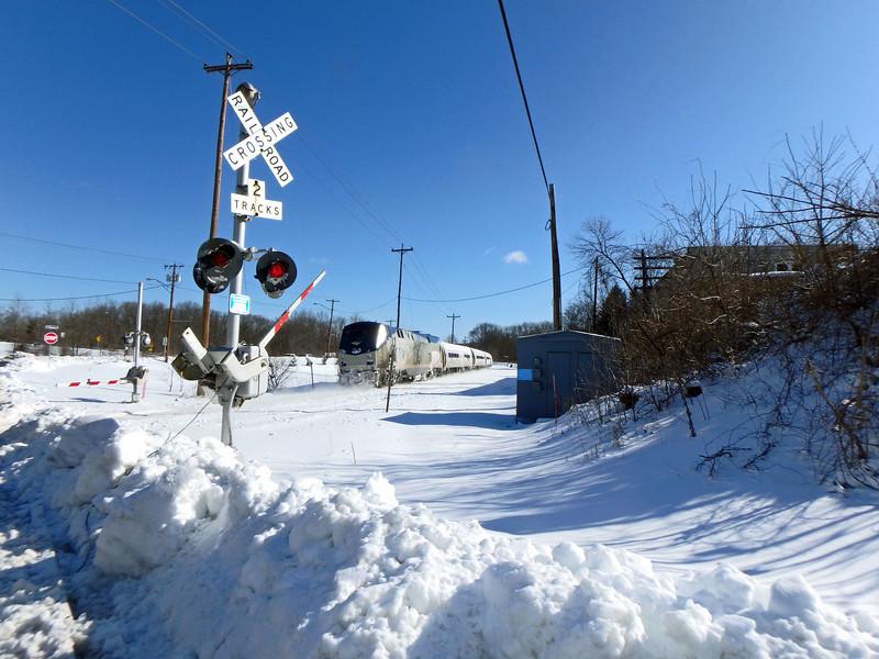 Marblehead Street Crossing Train 681 in Snow