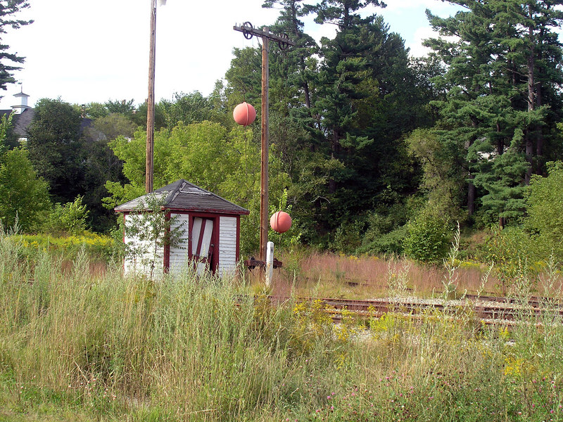 The ball signal at Whitefield, NH was still standing on Aug. 25, 2006. Not sure how much longer this piece of rail history will survive. It once protected the diamond crossing of the B&M and Maine Central railroads. Both lines are now shortlines.