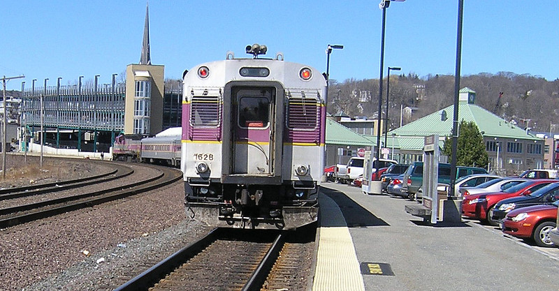 March 29, 2007 - Commuter train at the new Fitchburg rail & bus terminal with commuter parking garage in background. Main line freight tracks are to the left.