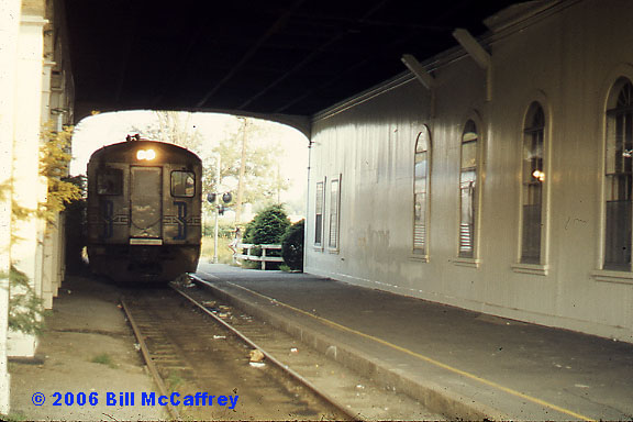 Lexington, Mass. - From the 1970's. - A B&M Budd RDC is entering the train shed of Lexington Depot.  The depot was  a bank when this photo was taken  but it still saw one train a day.