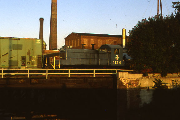 Switcher 1124 on the south end of the Manchester and Lawrence Branch bridge over the Merrimack River. In Lawrence, Massachusetts