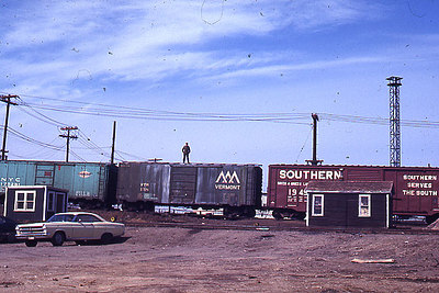 Mystic Junction near Boston - This slide was taken in the early seventies when it was still legal for barkemen to ride the tops of freight cars.