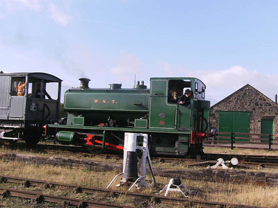 W S T seen returning with a coal train. In the foreground is one of the pulleys for the rope worked incline to Blackhams Hill.