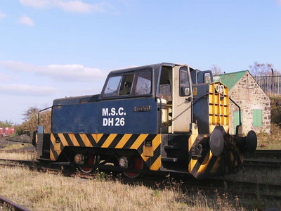 MSC DH26 parked behind the wagon repair shop