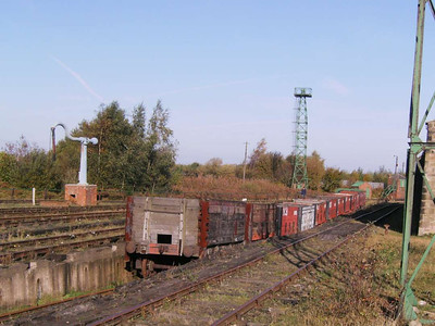 A line of wooden bodied colliery wagons in a sunken line