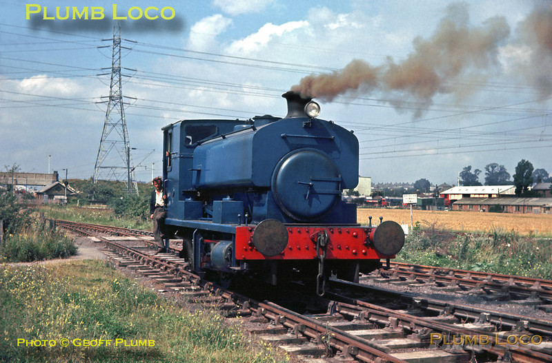 """Not all industrial railway systems were in the """"traditional"""" industrial areas - here a Barclay 0-4-0ST (OC) works No. 2353 is pottering around in the exchange sidings with BR at West Thurrock power station in Essex. Quite what the engine is burning to produce the brown smoke I'm not sure! Alongside are the electrified tracks of the former London, Tilbury & Southend Railway from Barking via Tilbury to Southend. Wednesday 7th August 1963. Slide No. 235."""