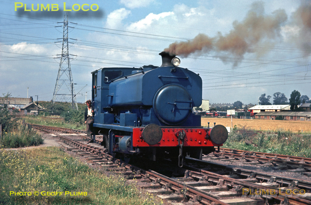 "Not all industrial railway systems were in the ""traditional"" industrial areas - here a Barclay 0-4-0ST (OC) works No. 2353 is pottering around in the exchange sidings with BR at West Thurrock power station in Essex. Quite what the engine is burning to produce the brown smoke I'm not sure! Alongside are the electrified tracks of the former London, Tilbury & Southend Railway from Barking via Tilbury to Southend. Wednesday 7th August 1963. Slide No. 235."