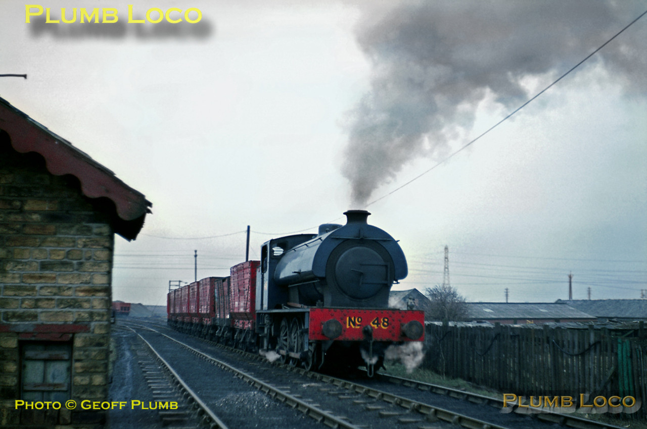 """Austerity"" 0-6-0ST No. 48 (Hunslet No. 2864/1943) has been doing some shunting at West Allotment sidings and is now heading towards Backworth with a train of empty internal user wagons, to be refilled with coal. March 1969. Slide No. 3633."