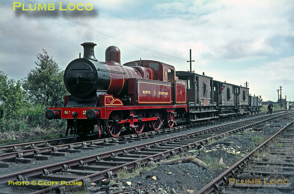 "From the Geoff Plumb Collection of original slides. NSR 0-6-2T No. 2, ""New L"" class, sits at Astley Moss on the Walkden Colliery system on Monday 3rd August 1964, during a visit and tour by the Birmingham Locomotive Club (Industrial Railway Society). The loco had been purchased by Manchester Collieries from the LMS in around 1930, along with several others, and had been loaned to the City of Stoke-on-Trent for its Golden Anniversary celebrations. The loco was sent to Crewe and restored in NSR livery and eventually returned to Walkden where it remained in use until the late 1960s. It was then preserved at the NRM, it is presently at Shildon. Photo courtesy John Edgington. Collect Slide No. 1051."