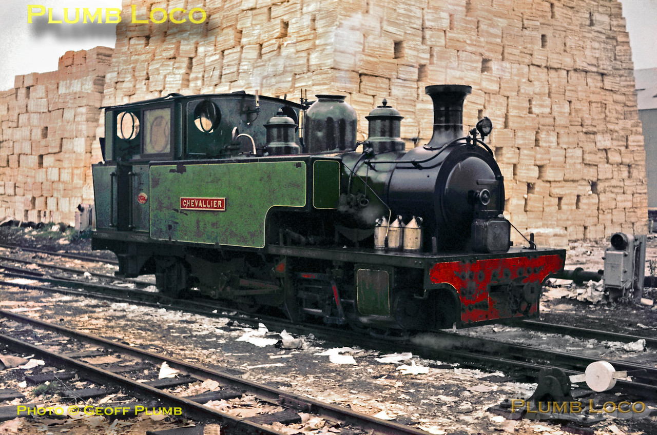 """Manning Wardle 0-6-2T, Works No. 1877 of 1915, """"Chevallier"""" simmers amidst the mountains of paper near Ridham Dock, on the Bowater's system. The loco was originally based on the Chattenden & Upnor naval railway and was sold to Bowater's in 1950. It subsequently moved to the Great Whipsnade Railway and is now owned by Bill Parker. Saturday 21st September 1963. Slide No. 401."""