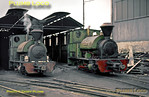 "On the Bowater's Paper Mills system at Sittingbourne in Kent, two Kerr Stuart 0-4-2STs are ready for work outside the loco depot on the 2' 6"" gauge line. On the left is ""Excelsior"", Works No. 1049 of 1908, while on the right is ""Leader"", Works No. 926 of 19xx (?). Note the spark-arresting chimneys! Saturday 21st September 1963. Slide No. 398."