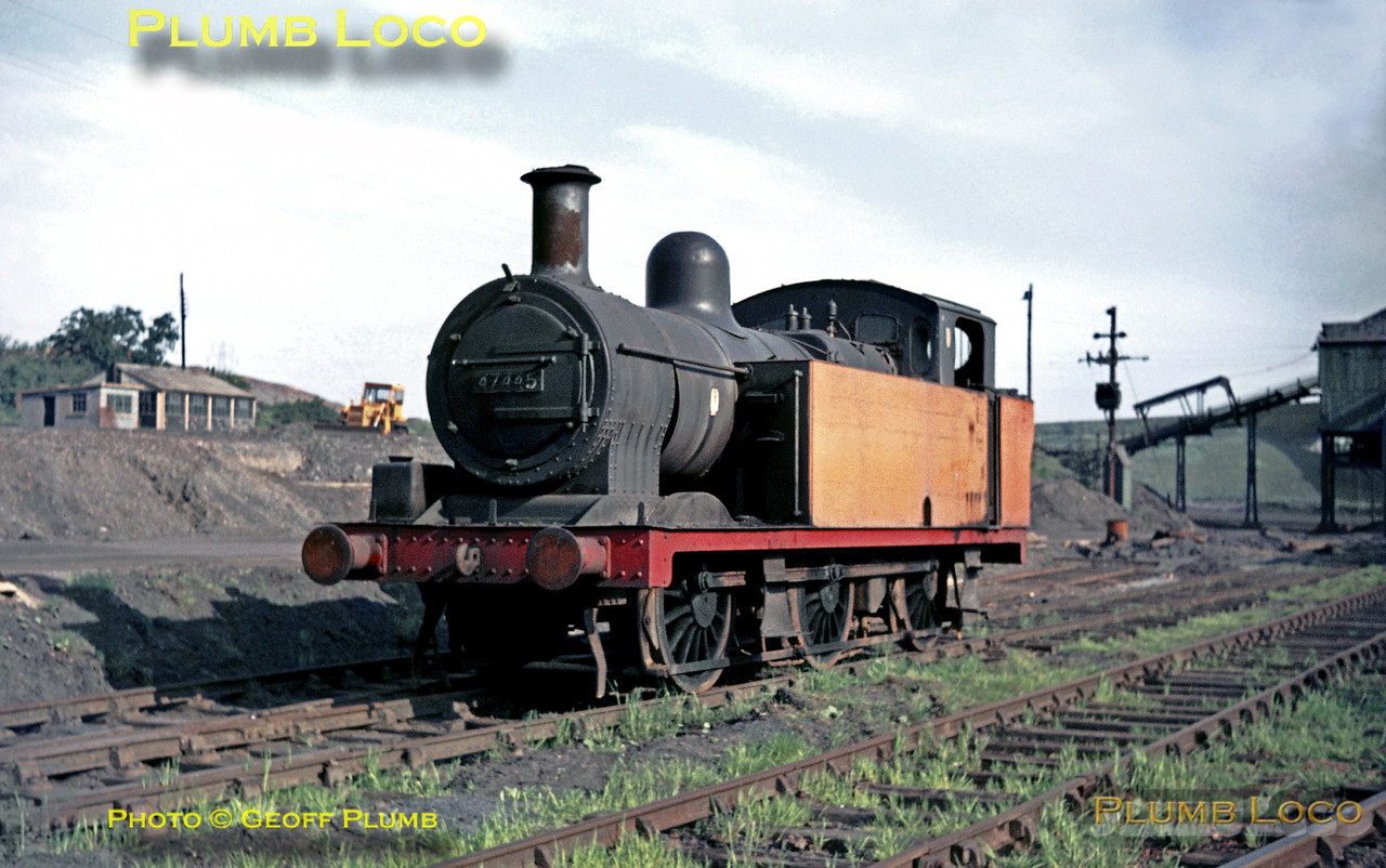 "Ex-LMS & BR Fowler ""Jinty"" 3F 0-6-0T No. 47445 at Pepper's Yard British Oak site at Crigglestone near Wakefield in West Yorkshire. It was out of use at this stage (or newly arrived from another site?), but was later in use again here and the engine survives until today! Saturday 1st June 1968. The embankment and end of the viaduct in the background beyond the loading hopper is the long closed  ex-Midland Railway line from Royston Junction  to Dewsbury. Slide No. 3296."