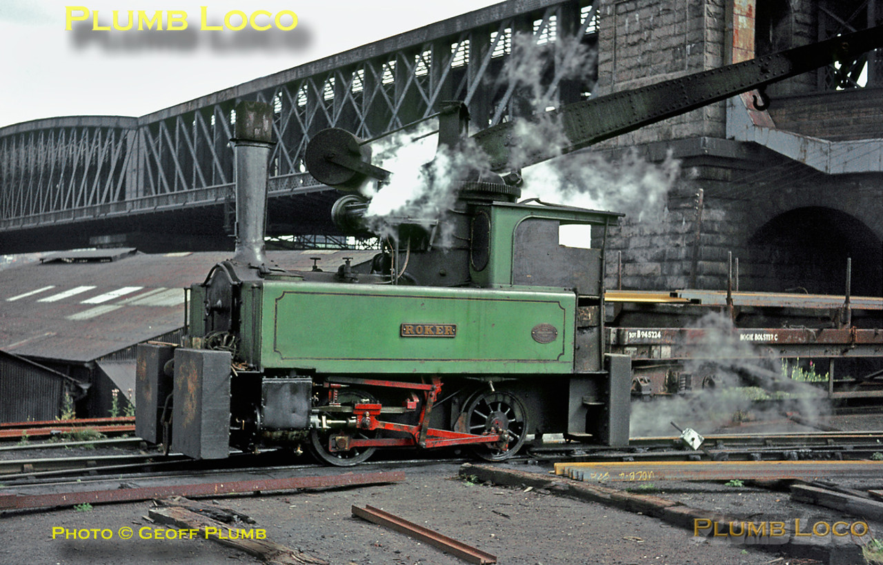 "At the Pallion Shipyard of William Doxford & Sons Ltd. in Sunderland, one of the 0-4-0CT OC Crane Tanks, ""Roker"" (Robert Stephenson & Hawthorn 7006/1940) is in action unloading steel girders from a BR Bogie Bolster wagon. Tuesday 3rd August 1965. These engines were unusual as they had outside Joy's valve gear. Slide No. 1528."