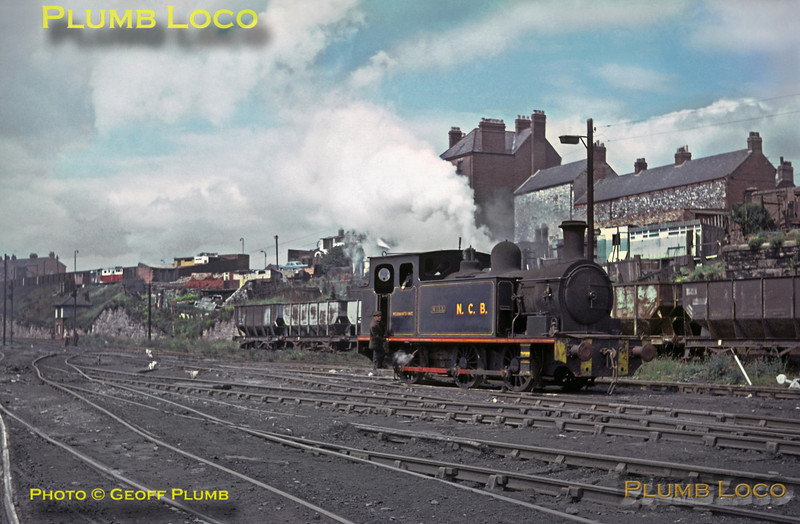 "Barclay 0-6-0T ""Will"" No. 999/1904 shunts in the yard at Wearmouth Colliery in Sunderland on Tuesday 3rd August 1965. This was one of the last pits in the area, not closing until 1994. The building behind the loco is the ""Mill House Inn"", now renamed ""The Halfway House"" and still extant on Southwick Road. Where the loco is standing is now the A1290 ""Keir Hardie Way"" and behind the camera is now the ""Stadium of Light"" on the site of the colliery. Slide No. 1542."
