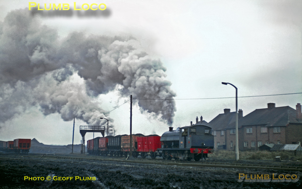"""A loaded coal train from Fenwick Colliery blasts its way into the yard at Backworth with an engine on each end, both running bunkerfirst. On the front is 0-6-0ST (OC) No. 44 (RSH 7760/1953) and out of sight on the rear is """"Austerity"""" 0-6-0ST No. 6 (WB 2749/1944), both quite clean considering the environment! March 1969. Slide No. 3638."""