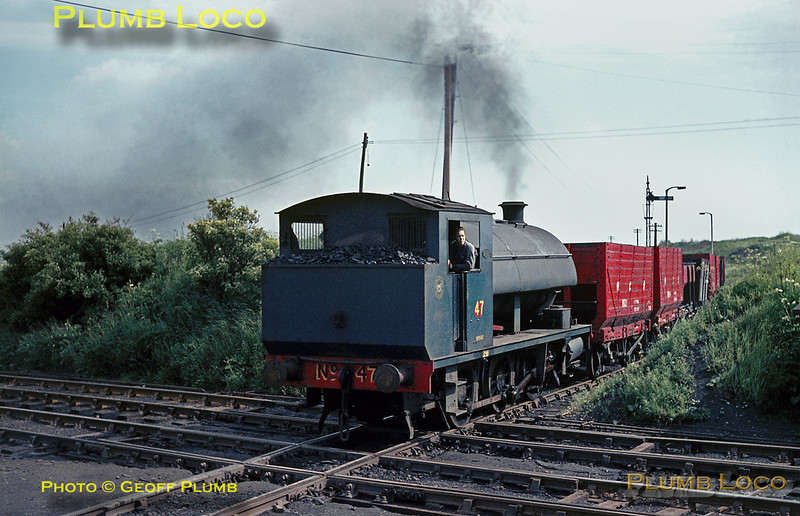0-6-0ST (OC) NCB No. 47 (RSH 7849/1955) brings a train of ancient ex-NER wagons over the level crossing of the BR Blyth & Tyne line as it works from Fenwick Colliery towards Eccles Colliery on the Backworth system. The signal protecting the crossing has already been put back to danger. June 1969. Slide No. 3882.