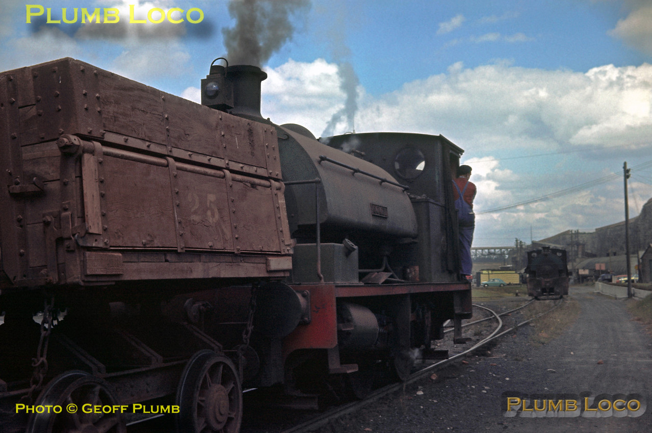 """Bagnall 0-4-0ST """"Comet"""", No. 2879 of 1948, was the newest steam loco at the Thurrock Chalk & Whiting Co. (Alpha Cement) and is seen here entering the yard having returned from the Thames-side wharf with a train of tipper wagons. Beyond is Peckett 0-4-0ST """"Thurwhit"""", No. 1734 of 1927, Wednesday 7th August 1963. Slide No. 238."""