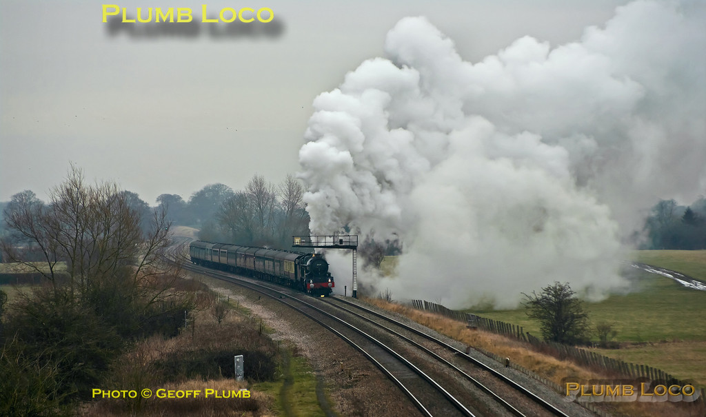 """Due to a signalling failure in the area, trains were being held at each signal for some time and a queue had built up. Having been held at the previous signal for around 30 minutes, 6024 """"King Edward I"""" moved forward to this signal just east of Shrivenham and was held for another eight minutes before getting the road. It then made a volcanic start with the 13 coaches of 1Z29, """"The Cathedrals Express"""" from Paddington to Bristol. 12:58, Sunday 12th February 2012. Digital Image No. GMPI11024."""