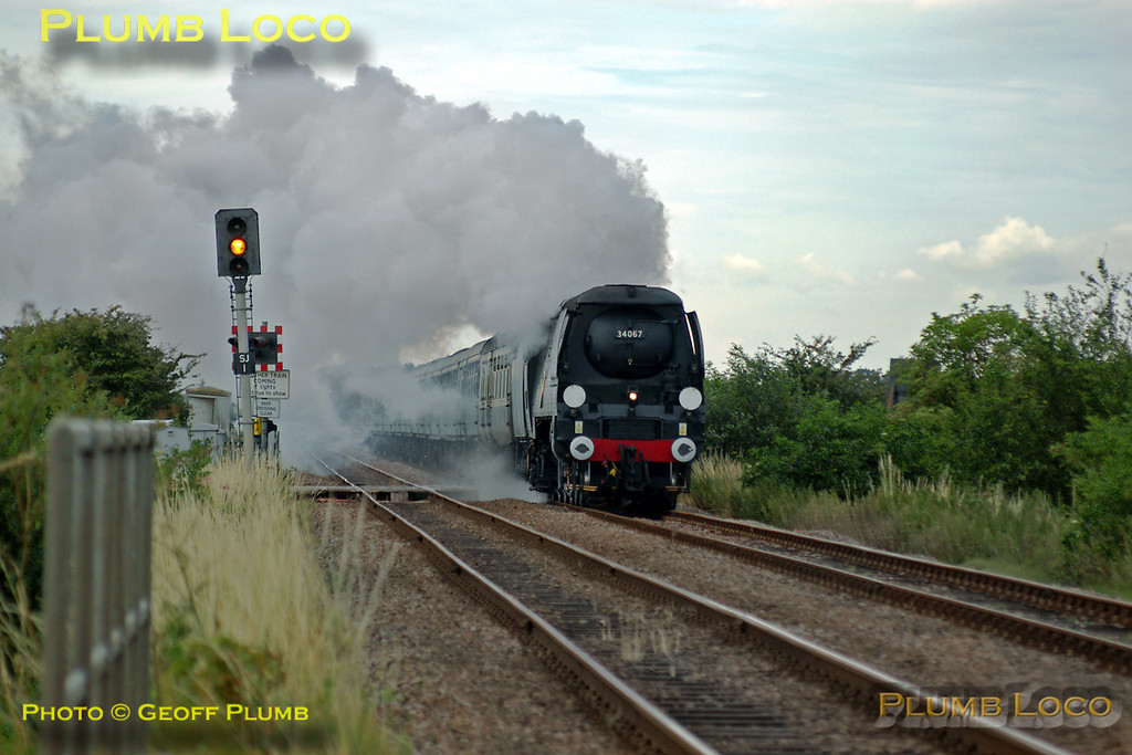 "Bulleid SR unrebuilt ""Battle of Britain"" class 4-6-2 No. 34067 ""Tangmere"" is hard at work near Deeping St. James with 1Z48, ""The Lincolnshire Coast Express"" from King's Cross to Skegness, running around 30 minutes late at 09:40 with 12 coaches in tow. Saturday 10th July 2004. Digital Image No. IMGP0391."