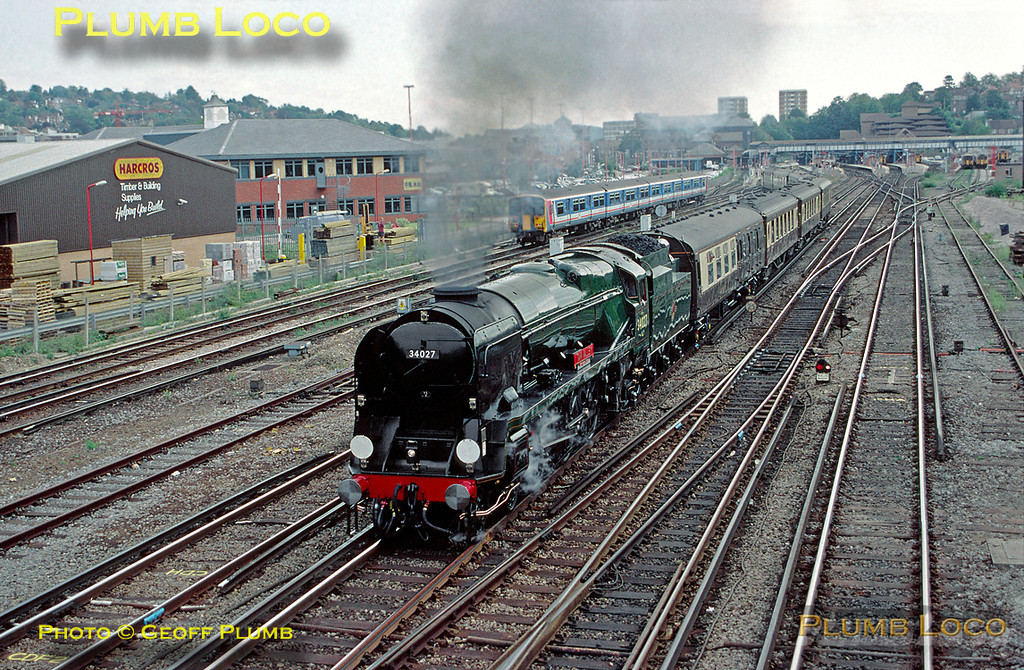 """Rebuilt Bulleid """"West Country"""" class 4-6-2 No. 34027 """"Taw Valley"""" restarts the VSOE """"Surrey Hills Luncheon Pullman"""" away from Guildford at 15:05 (due off 14:37) after a water stop, now bound for London Victoria. Friday 3rd October 1997. Slide No. 26440."""