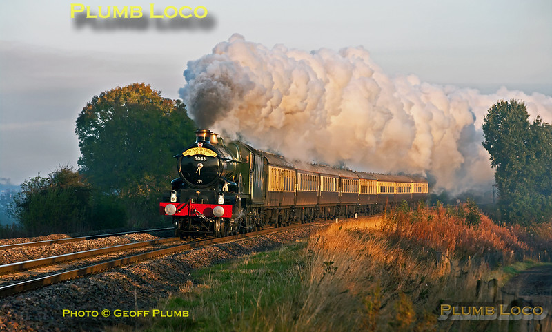 """Just a few minutes after sunrise and with the temperature just above freezing, GWR Castle Class 4-6-0 No. 5043 """"Earl of Mount Edgcumbe"""" puts on a wonderful display as it heads south at Clattercote crossing with 1Z43, the Oxford University Railway Society 80th Anniversary special train. This departed from Solihull at 07:05 and heading for Bath via the Berks & Hants line. 08:02, Saturday 15th October 2011. Photo taken from a public footpath across the line. Digital Image No. GMPI10410."""