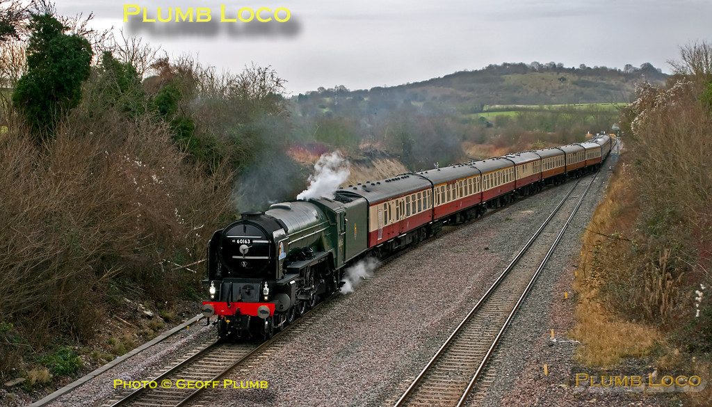 """A1 class 4-6-2 No. 60163 """"Tornado"""" crosses from the down line to the up line as it approaches Princes Risborough with 1Z27 """"The William Shakespeare"""", 08:03 from Paddington to Stratford-upon-Avon. This move into the up platform was to allow the following Chiltern loco-hauled service to overtake and also an up Chiltern non-stop service to use the through line. As """"Tornado"""" was running a few minutes late, the up train had already passed, but the train was still put in the up platform road after being stopped at signal ME159 in the background... 09:07, Friday 30th December 2011. Digital Image No. GMPI10758."""