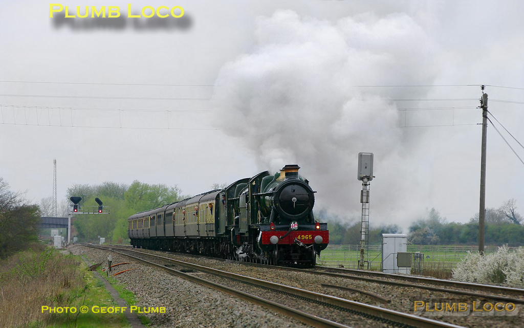 "GWR 4-6-0s Nos. 4965 ""Rood Ashton Hall"" and 5043 ""Earl of Mount Edgcumbe"" are double heading 1Z45, ""The Coronation Express"", Tyseley Warwick Road to Didcot via Cheltenham and Swindon. They have just passed the site of Wantage Road station and have opened up for the final stretch to Didcot, running some ten minutes early at 11:44 on Saturday 2nd April 2011. The train was run in conjunction with the public launch of restored 6023 ""King Edward II"" at Didcot Railway Centre. Photo taken from a public footpath across the line."