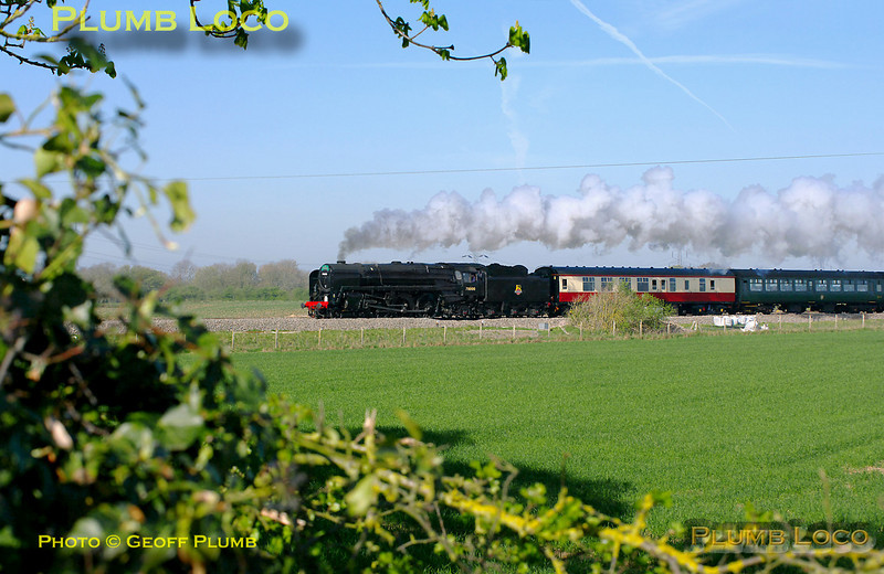 "On its first revenue earning run since its return from overhaul, BR Standard 4-6-2 No. 70000 ""Britannia"" is running in plain black BR livery without its nameplates. It is passing Cholsey Manor Farm with 1Z71, ""The Cathedrals Express"", 09:22 from Oxford to Canterbury and return, a few minutes late at 09:53 on Thursday 7th April 2011. Digital Image No. GMPI8493."
