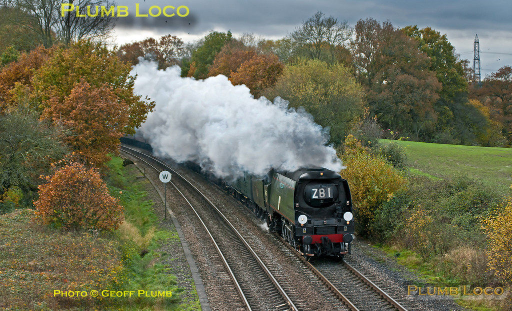 "SR unrebuilt ""Battle of Britain"" 4-6-2 No. 34067 ""Tangmere"" is working nicely at the head of 1Z92, ""The Capital Christmas Express"", 08:25 from Weymouth to Paddington at Silchester on the line from Basingstoke to Reading. The loco had adhesion problems in the earlier part of the trip and at one stage was around 90 minutes late, by this time it had regained some of the time and was around 70 minutes late at this point. 12:41, Saturday 17th November 2012. Digital Image No. GMPI12914."