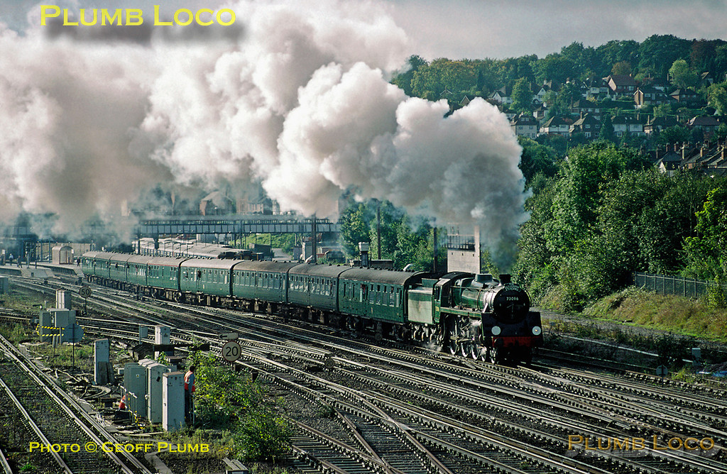 "BR Standard 5MT 4-6-0 No. 73096 makes a noisy departure from Guildford with 1Z96 ""The Gloucester Standard"", from the Mid-Hants Railway to Gloucester and return at 10:07 (due 09:53) with 9 Coaches in tow. Sunday 11th October 1998. Slide No. 27258."