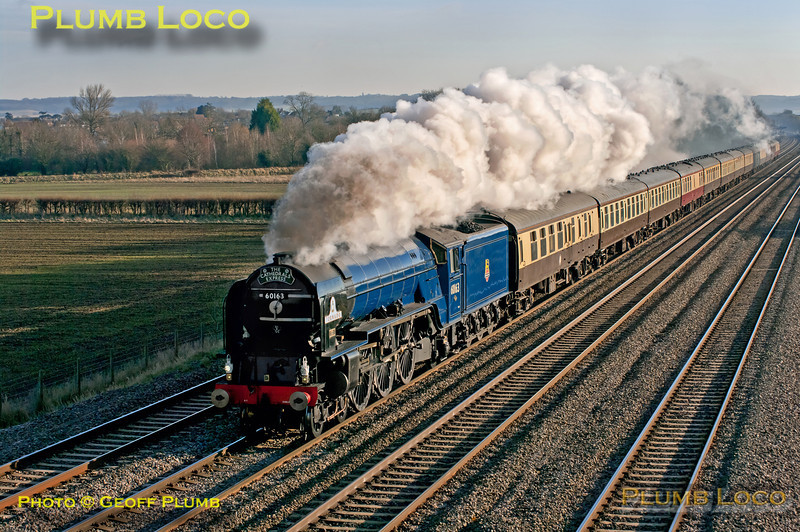 "LNER A1 class 4-6-2 No. 60163 ""Tornado"" has just passed Cholsey station and is approaching the bridge at Manor Farm on the down relief line with 1Z72, ""The Cathedrals Express"", 09:24 from Southend Central to Oxford. 13:06, Saturday 8th December 2012. At last - a picture of ""Tornado"" in blue livery in sunshine! Digital Image No. GMPI13208."