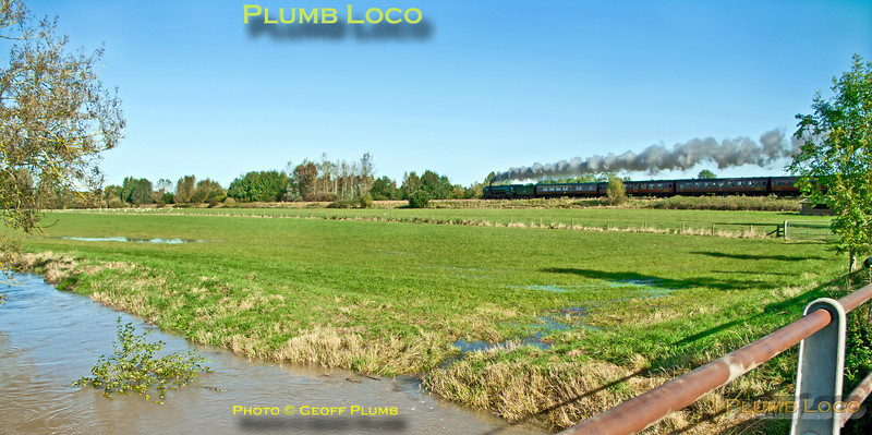 """The River Evenlode is in full spate in one direction while """"Britannia"""" 4-6-2 No. 70013 """"Oliver Cromwell"""" is in full cry in the other direction. It is working hard at the head of 1Z71, """"The Cotswold Venturer"""", 08:05 from Paddington to Worcester via Evesham and return via Sapperton on Saturday 6th October 2012. In glorious, but awkwardly angled, sunlight the train is seen near Lyneham running on time at 11:06. Digital Image No. GMPI12514."""