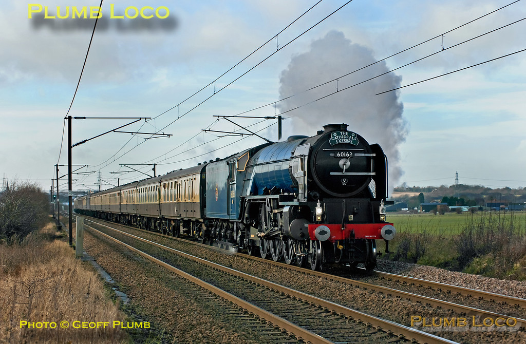 """Once more the sun decided not to play at the crucial moment as A1 4-6-2 No. 60163 """"Tornado"""" approaches the foot-crossing east of Baldock with 1Z86, """"The Cathedrals Express"""", 07:45 from Ashford International to Norwich, with 67022 on the rear, running around 17 minutes late. 11:40, Saturday 15th December 2012. At least the wind was blowing in the right direction for a change! Digital Image No. GMPI13265."""