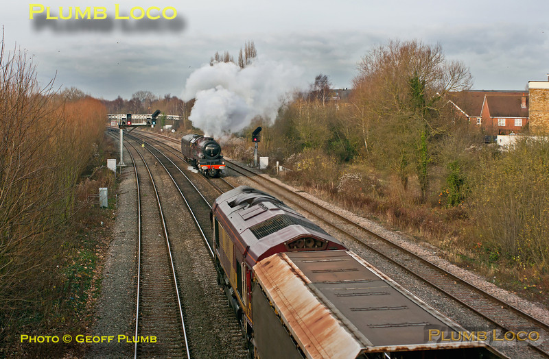 """LMS Stanier """"Princess Royal"""" class 4-6-2 No. 6201 """"Princess Elizabeth"""" is working just with its support coach in tow as 5Z70, 10:45 from Tyseley Loco Works to Southall, prior to the following day's trip to Worcester. It has just restarted from a signal stop at Oxford North Junction at 13:42 and heads south in weak sunshine, just as 66066 heads north with 6M48, Southampton Eastern Docks to Halewood empty car carrier - a very long train...  Friday 30th November 2012. Digital Image No. GMPI12987."""
