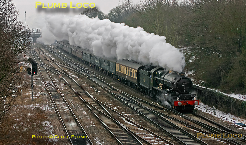 """GWR """"King"""" class 4-6-0 No. 6024 """"King Edward I"""" storms past Foxhall Junction, Didcot, running on the down main line with 1Z29, """"The Cathedrals Express"""", 10:07 from Paddington to Bristol Temple Meads and return via Newbury. The 13 coach train is running about a minute late at 11:18 on Sunday 12th February 2012, a very miserable day. Digital Image No. GMPI11013."""